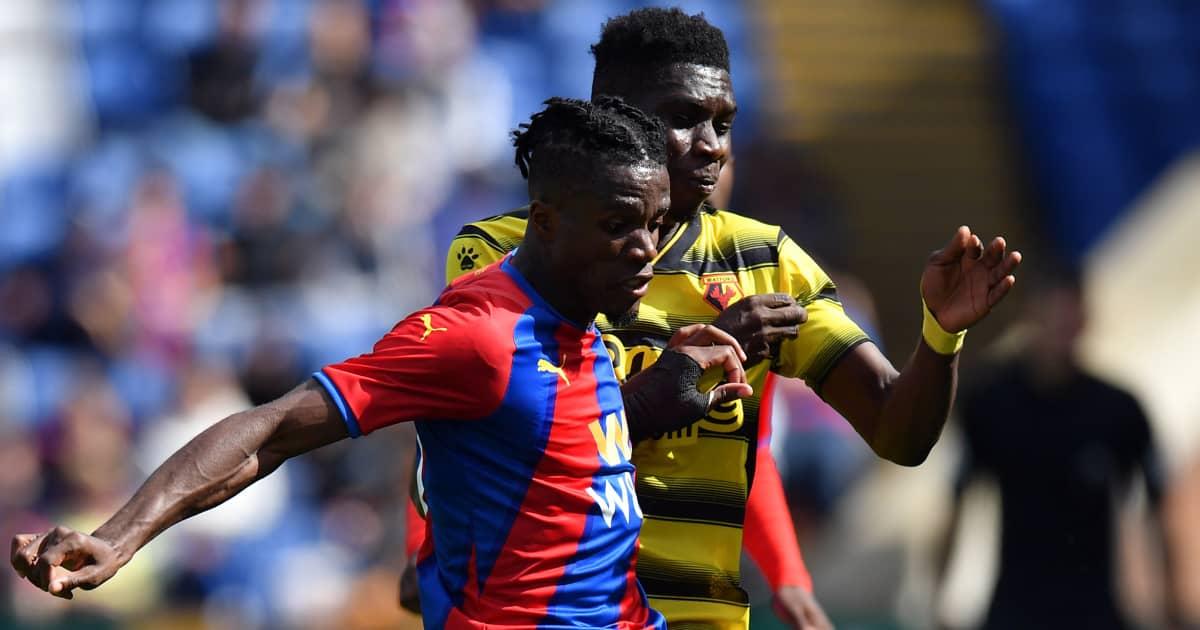 Wilfried Zaha tussling with Ismaila Sarr Watford v Crystal Palace 2021