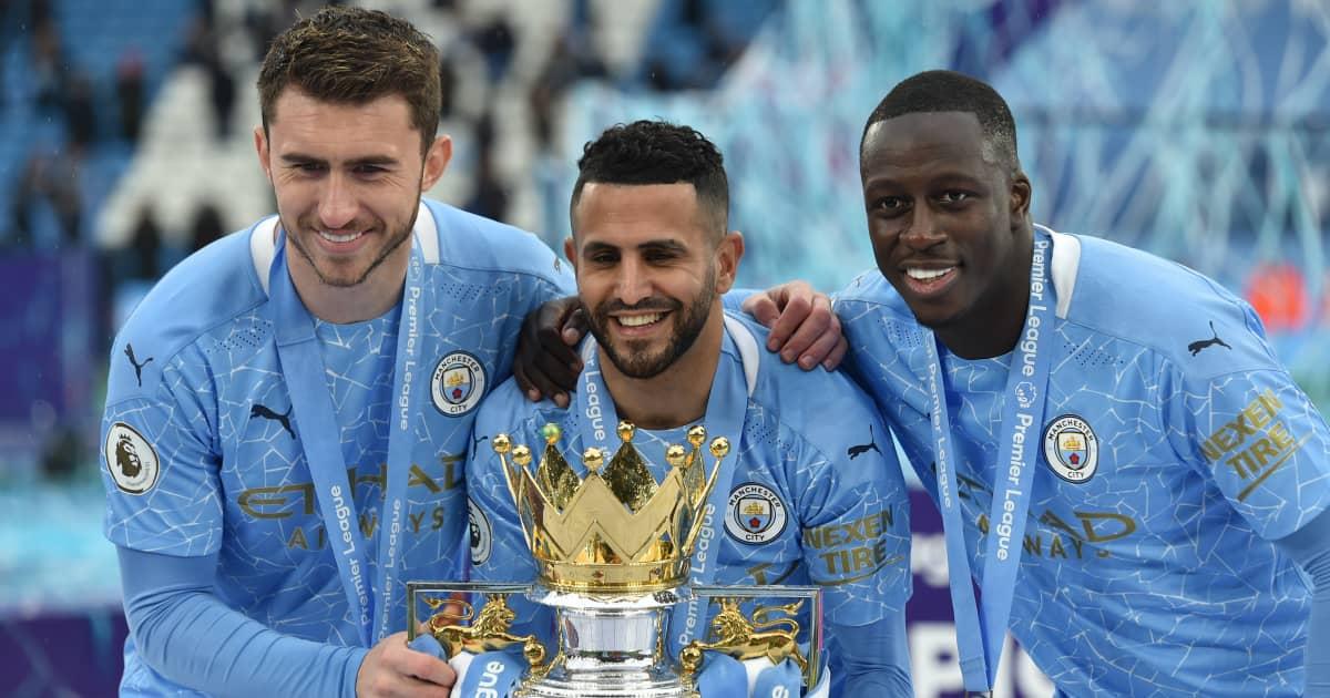 Man City trio Aymeric Laporte Riyad Mahrez and Benjamin Mendy holding the Premier League trophy 2021