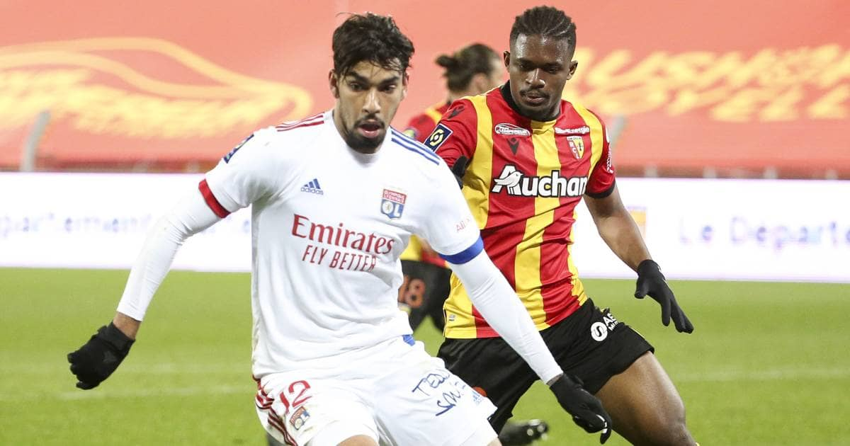 Lucas Paqueta against Cheick Doucoure in game between Lyon and Lens
