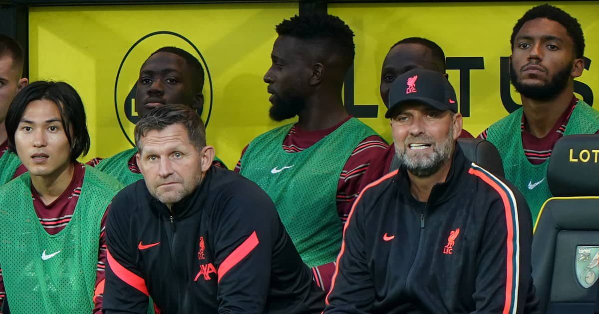 Liverpool players and manager watch on during their 3-0 victory over Norwich August 2021