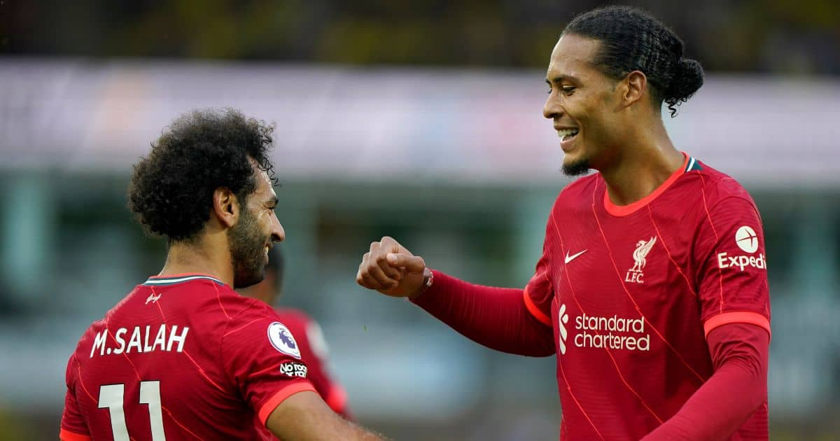 Liverpool FC's Mohamed Salah celebrates with Virgil van Dijk after scoring their side's third goal during the Premier League match at Carrow Road, Norwich
