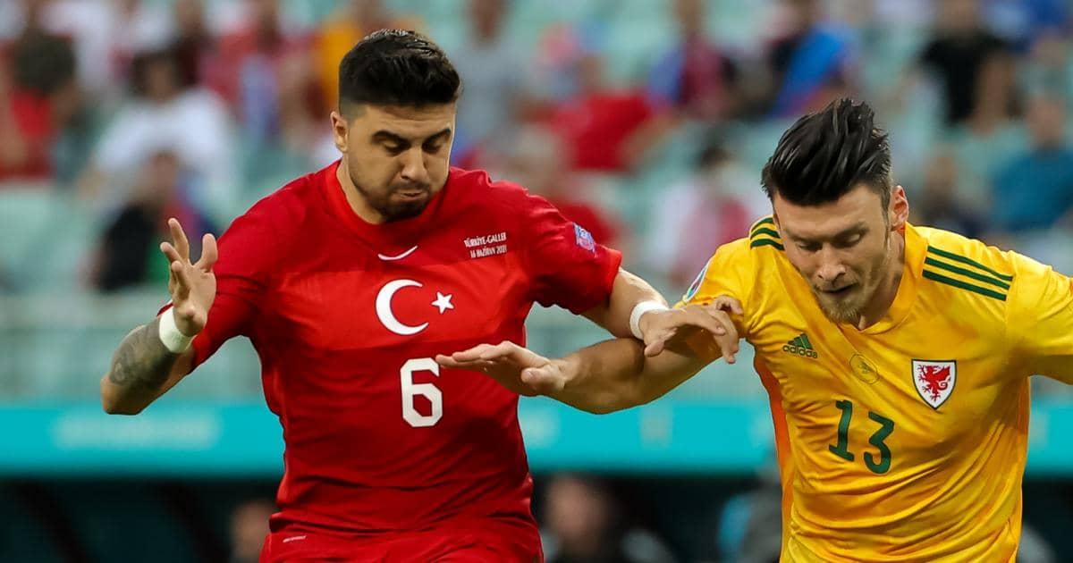 Ozan Tufan battles with Kieffer Moore in Turkey v Wales