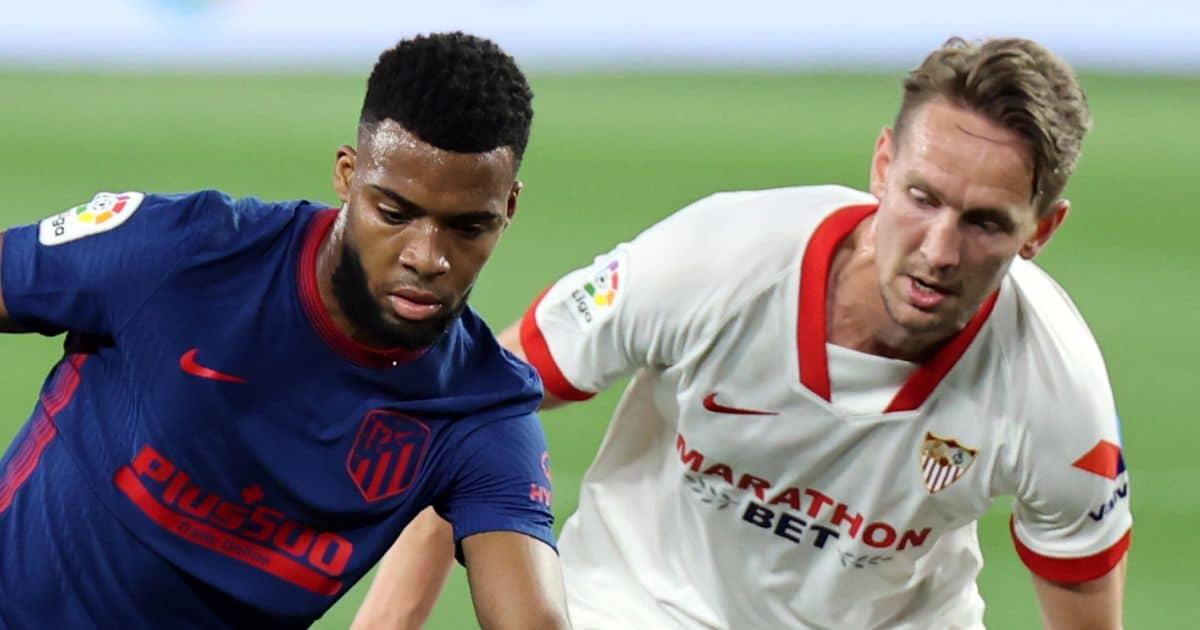 Thomas Lemar protects ball from Luuk De Jong in Sevilla v Atletico Madrid