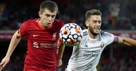 Liverpool FC's Ben Woodburn battles Osasuna's Roberto Torres