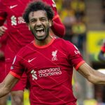 Mohamed Salah celebrates after scoring the third goal during the 2021-2022 season English Premier League first round match between Norwich City and Liverpool