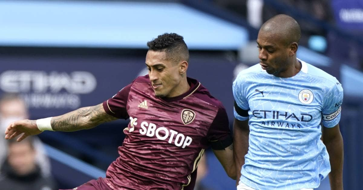 Raphinha and Fernandinho battle in game between Manchester City and Leeds United