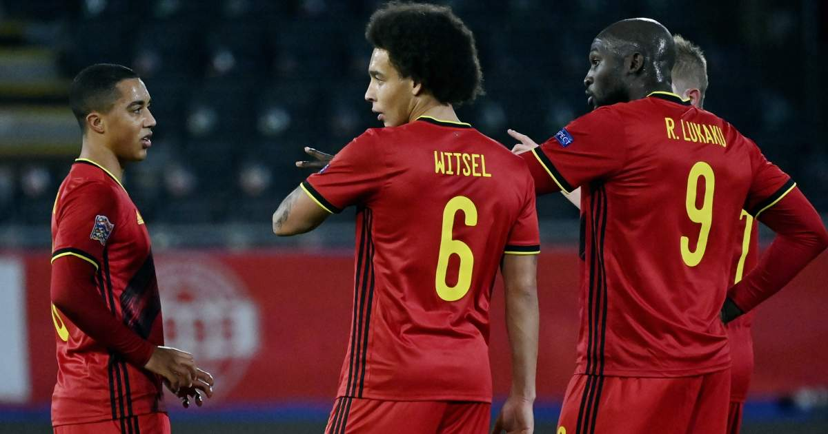 Axel Witsel, Youri Tielemans and Romelu Lukaku chatting whilst playing for Belgium in 2021