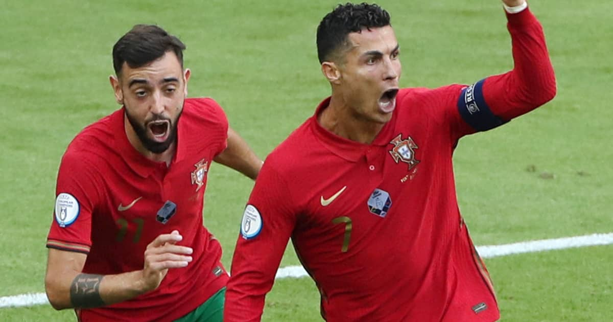 Portugal forwards Bruno Fernandes and Cristiano Ronaldo celebrate scoring a goal 2021
