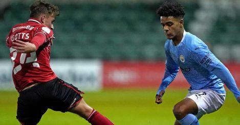 Robbie Gotts tackles Oscar Robb during Lincoln City vs Man City U23s, November 2020