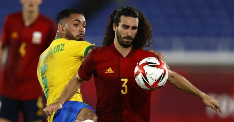 Douglas Luiz trying to win the ball from Marc Cucurella in match between Brazil and Spain