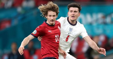 Alex Kral trying to keep ball away from Harry Maguire