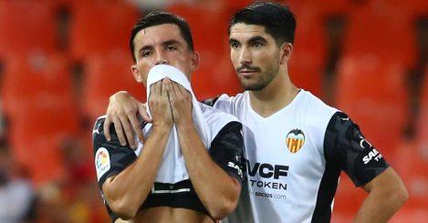 Hugo Guillamon and Carlos Soler react during Valencia v Getafe