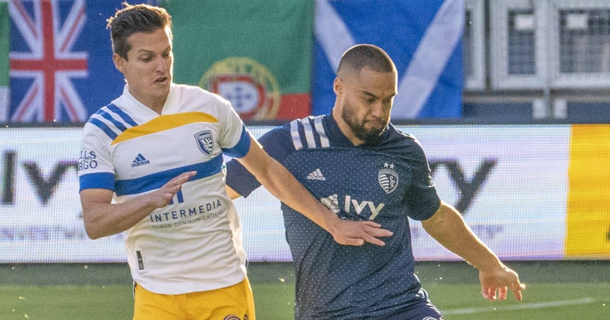 Sporting Kansas City defender Winston Reid (22) moves the ball as San Jose Earthquakes midfielder Carlos Fierro (21) defends during the first half at Children's Mercy Park. Mandatory