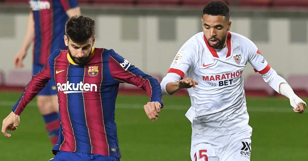 Gerard Pique and Youssef En-Nesyri tussle for possession, March 2021