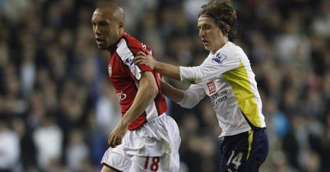 Mikael Silvestre of Arsenal tussles with Luka Modric of Tottenham, 2010