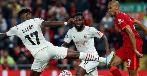 Rafael Leao battles with Fabinho as Frank Kessie looks on during Liverpool vs AC Milan
