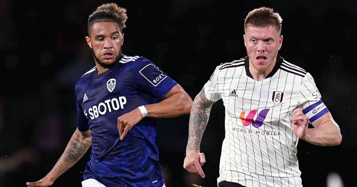 Leeds United's Tyler Roberts (left) and Fulham's Alfie Mawson battle for the ball during the Carabao Cup third round match at Craven Cottage