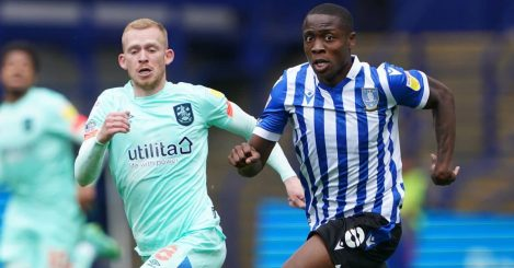 Sheffield Wednesday's Dennis Adeniran and Huddersfield Town's Lewis O'Brien battle for the ball during the Carabao Cup first round match at Hillsborough