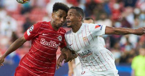 Karim Adeyemi of Salzburg and Fernando Reges of Sevilla in Champions League action