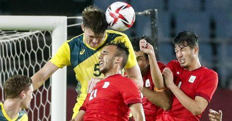 Australia defender Harry Souttar winning a header against Egypt 2021