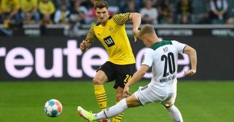 Dortmund star Thomas Meunier battling Monchengladback defender Luca Netz 2021