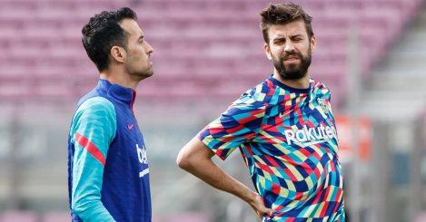 Barcelona midfielder Sergio Busquets alongside Gerard Pique 2021