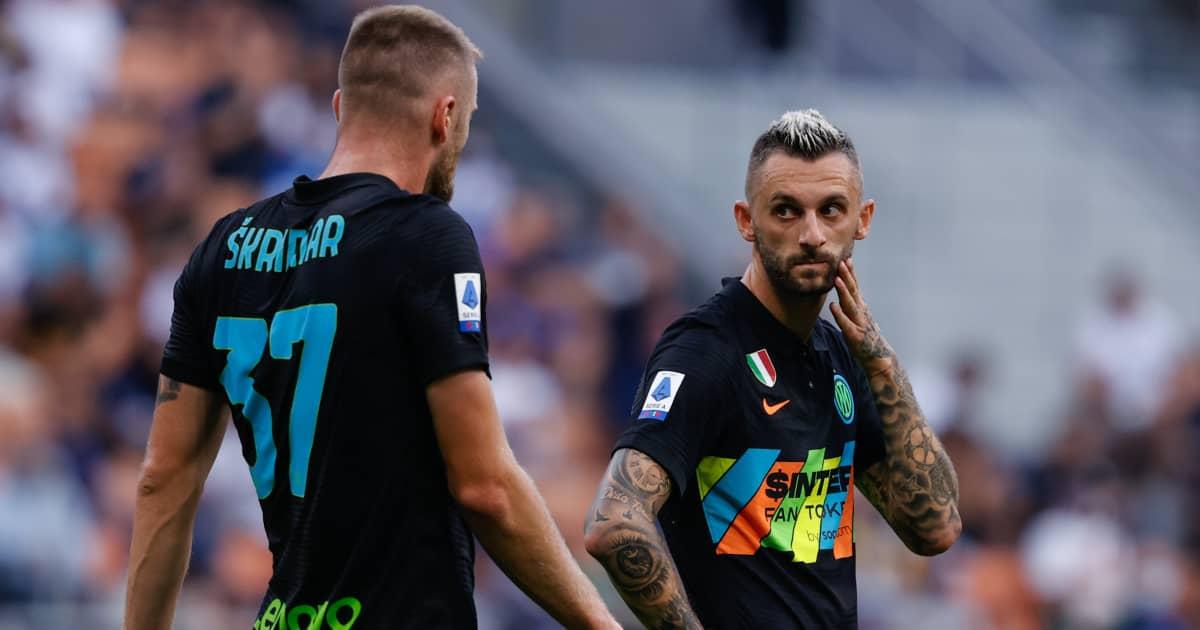 Inter Milan midfielder Marcelo Brozovic looking at teammate Milan Skriniar 2021