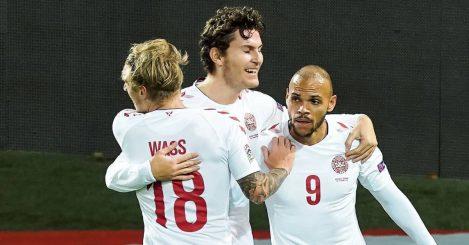 Denmark striker Jonas Wind celebrating with two teammates 2021