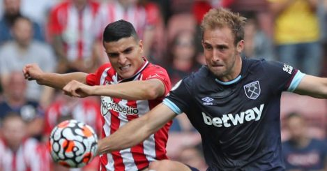 Mohamed Elyounoussi and Craig Dawson battling for the ball