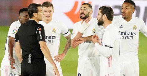 Real Madrid players Vinicius Junior, Toni Kroos, Karim Benzema, Eder Militao and Nacho Fernandez surround the referee, May 2021
