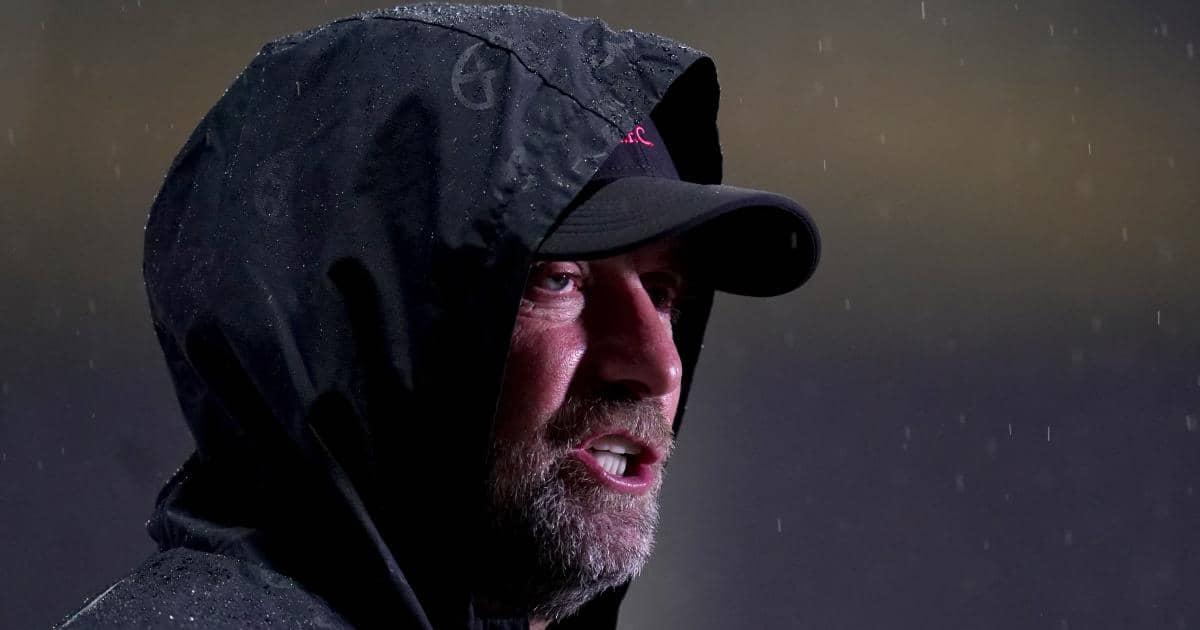 Jurgen Klopp being interviewed in the rain